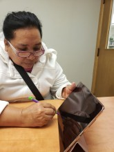 Photo of citizenship student using iPad